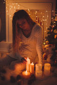 Girl with gifts and candles — Stock Photo