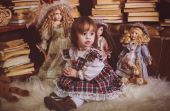 Little lady with dolls — Stock Photo