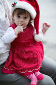 Little girl in Santa Claus clothes — Stockfoto