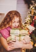 Girl and Christmas gifts — Stock Photo