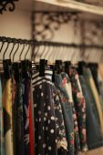 Fashionable clothes in cloak-room — Stock Photo
