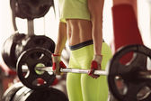 Woman on sport gym club — Stock Photo