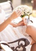 Bride sitting on a bench — Stock Photo