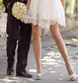 Legs newlyweds in wedding day — Stock Photo
