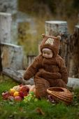 Baby girl in the suit of bear in park — Stock Photo