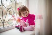 Little girl on a window sill — Foto Stock