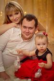 Happy family at Christmas — Stock Photo