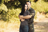 Woman and soldier embracing — Stock Photo