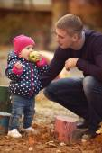 Father and daughter in autumn park — Stock Photo