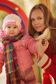 Happy mother with baby in autumn park — Stock Photo