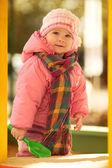 Baby girl in autumn garden — 图库照片
