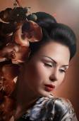 Japanese geisha woman with orchid — Stock Photo