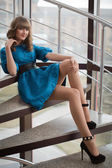 Beautiful girl sitting on the stairs — Stock Photo