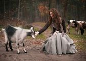 Beautiful young girl with goat — Stockfoto