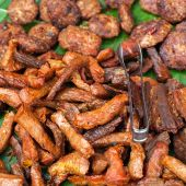 Traditional asian food at market. Delicious spicy grilled pork — Stock Photo