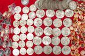 Old cheap souvenir coins for sale at asian market. Laos — Stock Photo