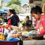 People selling food at asian market. Laos — Stock Photo #53845415