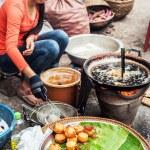 People selling food at asian market. Laos — Stock Photo #53845567
