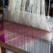 Vintage manual weaving loom with unfinished textile work — Stock Photo #54501655