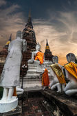 Praying Buddhas at Wat Yai Chai Mongkhon temple. Ayutthaya, Thailand — Stockfoto