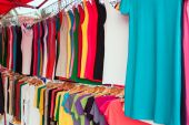 Colorful shirts for sale at market — Stock Photo