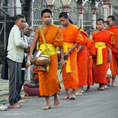 Buddhist monks at morning collecting food donation. Laos — Foto de Stock