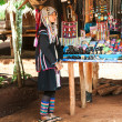 Akha woman in traditional clothes selling souvenirs — Stock Photo #55719427