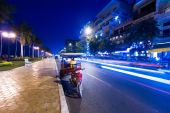 Moto taxi at evening asian city. — Stock Photo