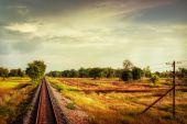 Railway track crossing rural landscape — Stock Photo