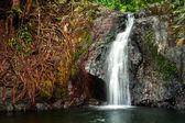 Small waterfall at tropical rain forest. Vang Vieng, Laos — Stock Photo