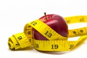 Apple with metre — Stock Photo