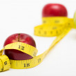 Red apple and measuring tape — Stock Photo #54408849