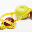 Red apple and measuring tape — Stock Photo #54408883