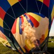 Hot air balloon being inflated in preparation for flight — Stock Photo #80325092