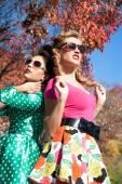 Two girls on a background of autumn trees — Fotografia Stock