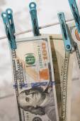 Money drying on the clothesline. The concept of money laundering — Stock Photo