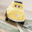 Toy car on a background of US dollars banknotes — Stock Photo #58992375