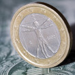 One euro coin on a dollar bill — Stock Photo #64372857