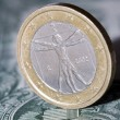 One euro coin on a dollar bill — Stockfoto #64372857