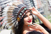 Caucasian woman in traditional headdress Indians — Stock Photo