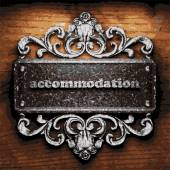 Accommodation vector metal word on wood — Stock Vector