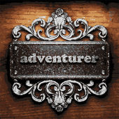 Adventurer vector metal word on wood — Stock Vector