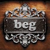 Beg vector metal word on wood — Stock Vector