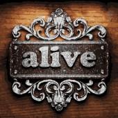Alive vector metal word on wood — Stock Vector