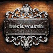 Backwards vector metal word on wood — Stock Vector