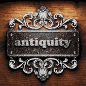 Antiquity vector metal word on wood — Stock Vector