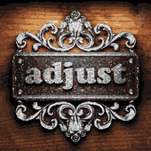 Adjust vector metal word on wood — Stock Vector