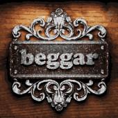 Beggar vector metal word on wood — Stock Vector