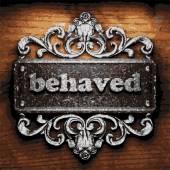 Behaved vector metal word on wood — Stock Vector