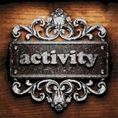 Activity vector metal word on wood — Wektor stockowy